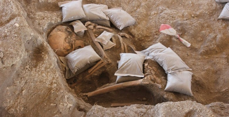 Burial in Area P with protective packing